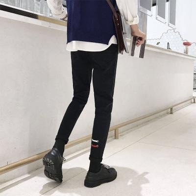 秋冬新款男士机眼织带水洗黑色牛仔裤青年小脚裤子P38(不低68)